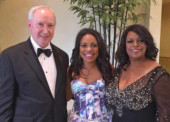 Aubrey Chernick posing with Mykesha Robinson and Earlyn Robinson.